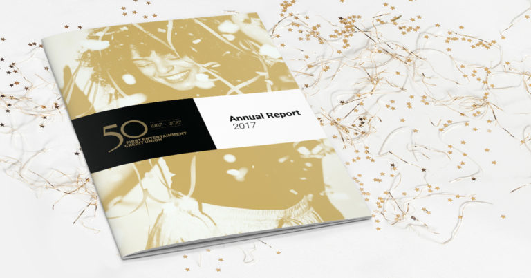First Entertainment Credit Union's 2017 Annual Report sits upon a table covered with confetti