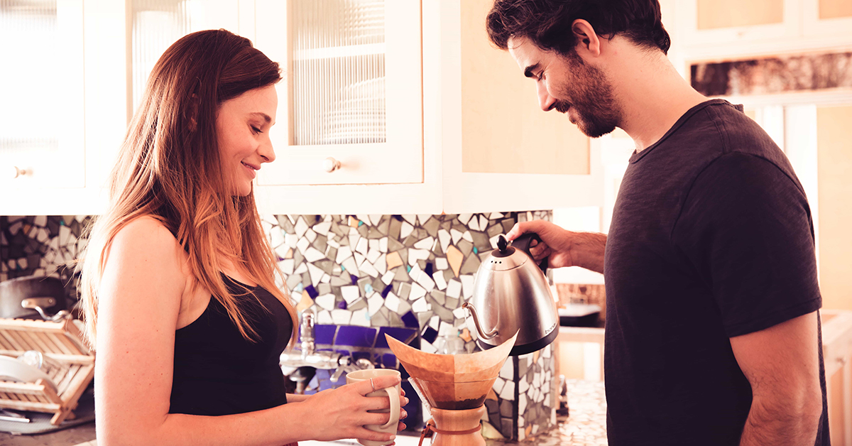 a man and woman make coffee in the morning