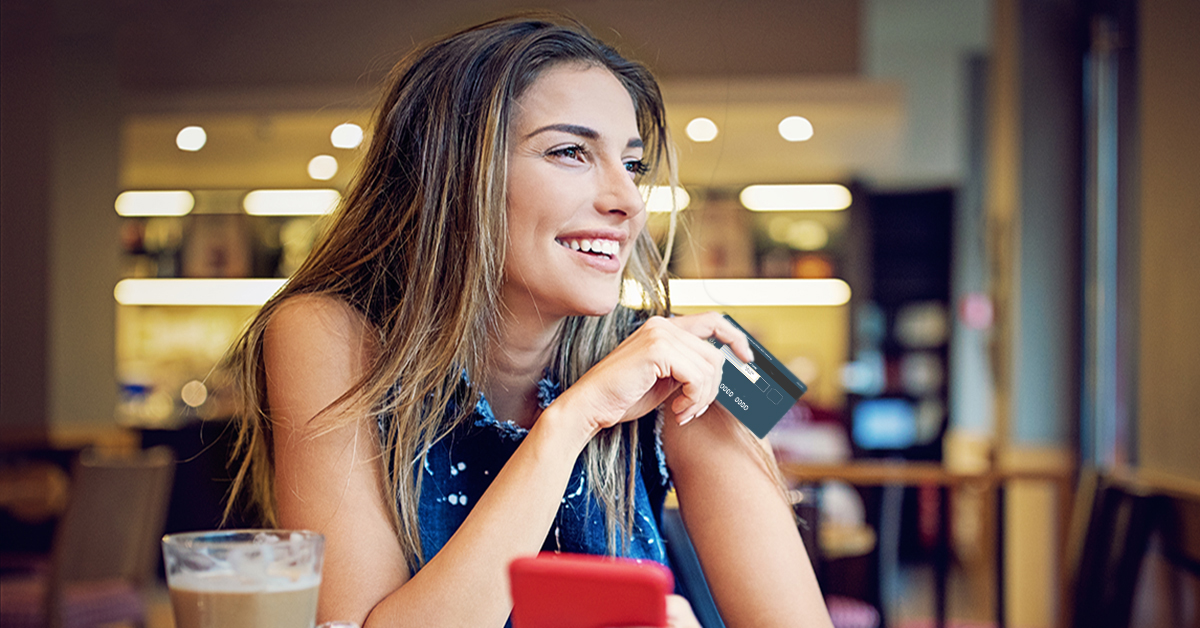 girl in coffeehouse with credit card