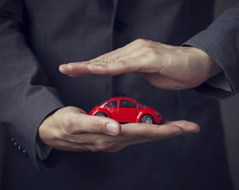 hands holding toy car gap insurance